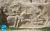 Battle_scene_of_Hormoz_II_and_relief_of_Azar-Narses